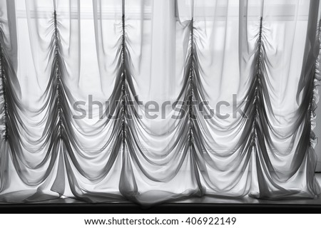Decorative white tulle with folds pattern, background photo texture - stock photo