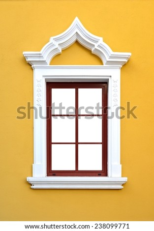 Decorative window / Window on yellow wall / Eisenstadt, Austria - stock photo
