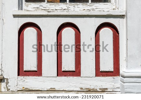 Decorative wood on house in need of repair - stock photo
