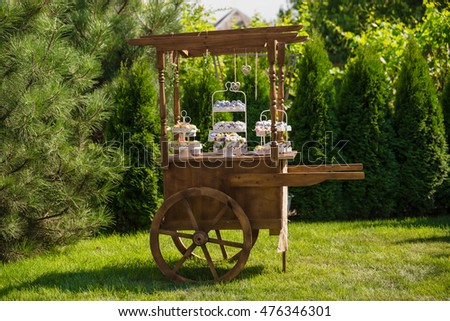 Decorative Wooden Cart In The Garden And Candy Bar