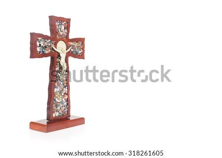 Decorative wooden Catholic Christian Crucifix with isolated white background - stock photo