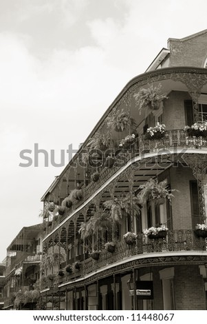decorative wrought iron balconies in the historic New Orleans French Quarter - stock photo