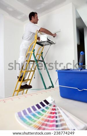 Decorator painting base coat - stock photo