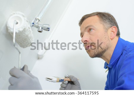 Decorator using a roller - stock photo