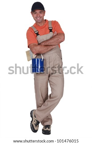 Decorator with a pot of paint - stock photo