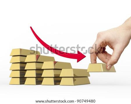 Decrease bar chart made of golden bars. Hand take off the bottom bar. Red arrow shows decrease. - stock photo