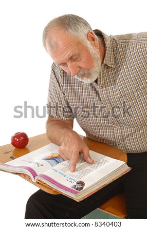 Dedicated, mature learner focused on the book in front of him