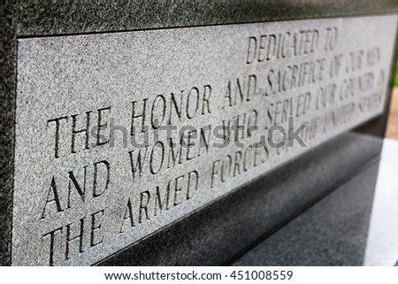"""Dedication monument for Armed Forces - """"Dedicated to the honor and sacrifice of our men and woman who served our country in the armed forces of the United States"""" - stock photo"""