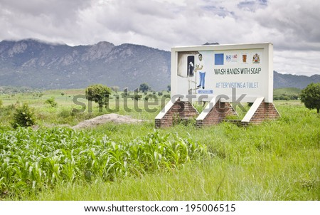 DEDZA, MALAWI - JANUARY 16: a billboard advises on good practice after visiting a toilet on January 16, 2014 in Dedza, Malawi. 1.4 million Malawians have no access to a latrine.  - stock photo