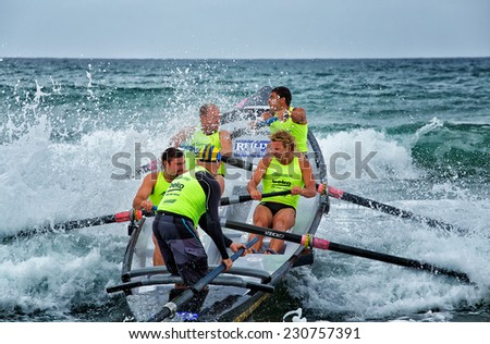 DEE WHY,AUSTRALIA - NOVEMBER 15,2014: Surf lifesavers competing in the Ocean Thunder surf boat competition. The contest is held over 4 summer Saturdays.
