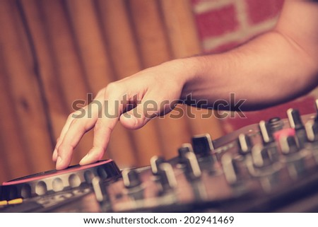 DeeJay hand close up while mixing - stock photo