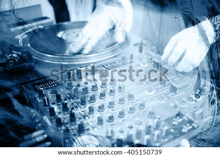Deejay's hands and turntables. Photo from nightclub. - stock photo
