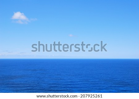 Deep blue sea waters and clear sky - stock photo