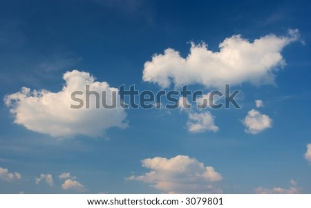 Deep blue sky with peaceful white clouds - stock photo