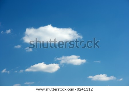 Deep blue sky with small blue clouds - stock photo