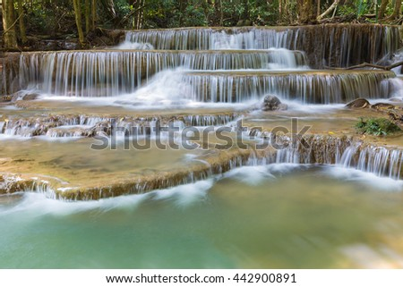 Deep blue stream waterfall in tropical forest in Thailand - stock photo