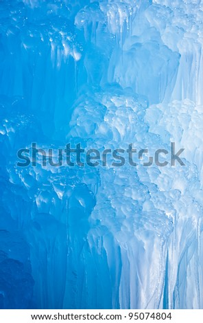 Deep blue Swiss Mountains icicles formation. - stock photo