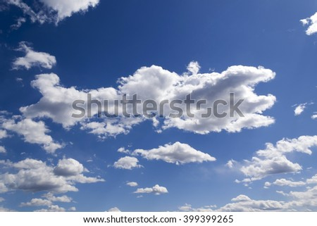 Deep clear sky with clouds. Full frame as background. Presentation template.Blue sky. Nature background. Bright sun rays in the sky. Sun shine through clouds. - stock photo