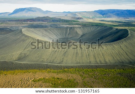 Deep crater seen from helicopter with other craters in the back. Myvatn area in Iceland - stock photo