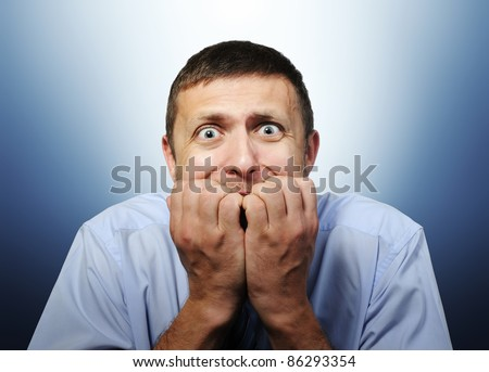 Deep fear of businessman - stock photo
