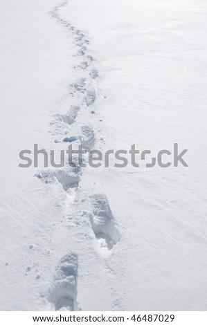 deep foot print on the snow - stock photo