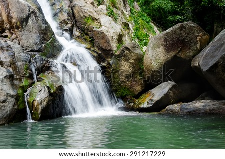 Deep forest  tropical waterfall on Thailand island - stock photo