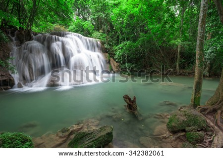 Deep forest waterfall at Huay Mae Kamin waterfall National Park Kanchanaburi Thailand