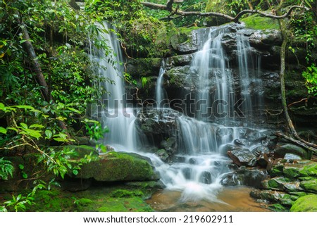 Deep forest waterfall at Phu Soi Dao National Park, Thailand.