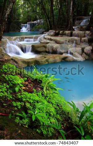 Deep forest waterfall, Erawan Waterfall, at National Park in Thailand - stock photo