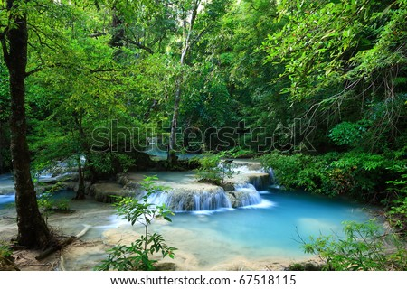 Deep forest waterfall in Thailand (Erawan Waterfall) - stock photo