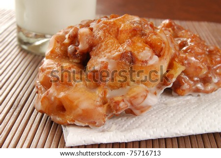 Deep fried apple fritters and a glass of milk - stock photo