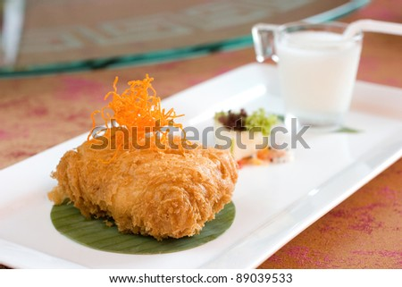 Deep fried battered durian cream cake with a side of coconut juice