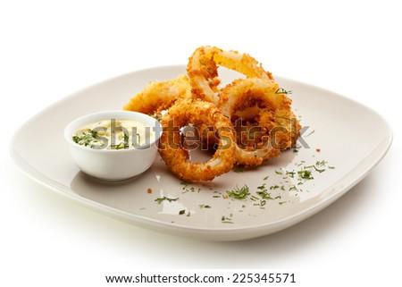 Deep Fried Calamari Rings with Sauce Bowl - stock photo
