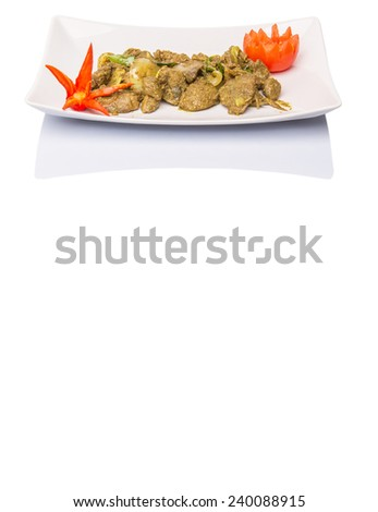 Deep fried chicken liver mix with curry powder and carved chili and tomato on white plate - stock photo