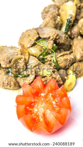 Deep fried chicken liver with carved tomato  - stock photo