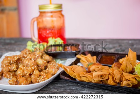 deep fried chicken tendons and thai traditional spring roll or Toong Tong - stock photo