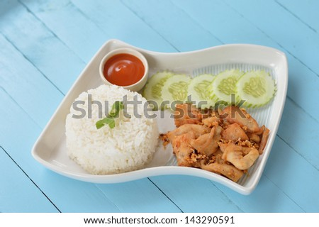 Deep fried chiken with steamed rice dish. - stock photo