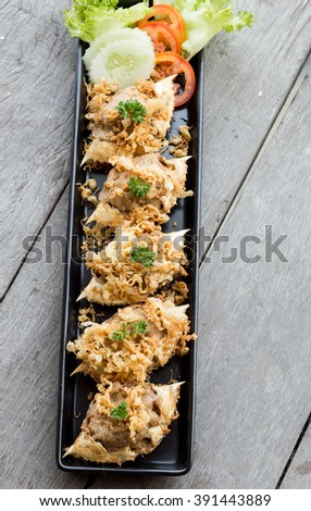 Deep-fried crab meat and minced pork in crab shell fritters served on a long plate. - stock photo