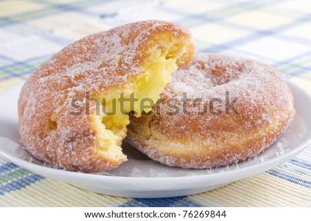 Deep-fried doughnuts (paczki) filled with lemon, often eaten on Fat Tuesday before Lent. - stock photo