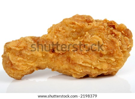 Deep fried fast food, spring chicken in golden lemon batter macro close up isolated on black white - stock photo