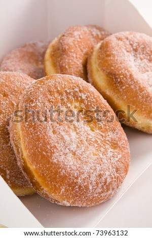 Deep-fried filled doughnuts (paczki) eaten on Fat Tuesday before Lent. - stock photo