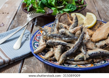 deep fried fish in a bowl with salad - stock photo