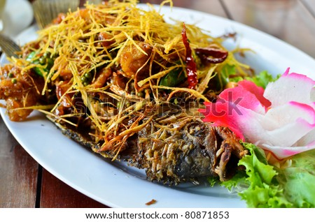 deep fried fish with lemongrass , Thai style food