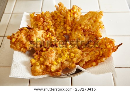 Deep fried ote-ote, Indonesian traditional snack made from corn, carrot, flour and shrimp - stock photo