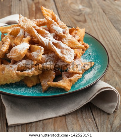Deep-fried pastry on plate. Selective focus - stock photo