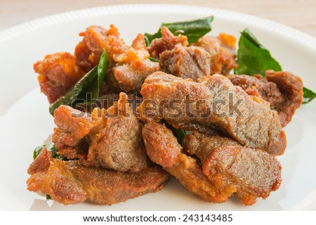 Deep fried pork with leech lime leaf
