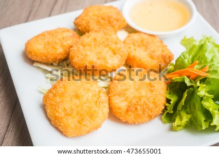 Deep fried shrimp cake in white plate