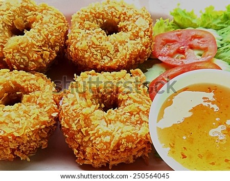 Deep-fried shrimp cakes with dipping sauce. - stock photo
