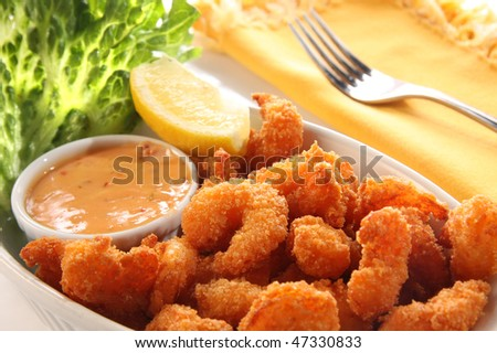 Deep fried shrimp platter, also known as popcorn shrimp. Also available in vertical. - stock photo