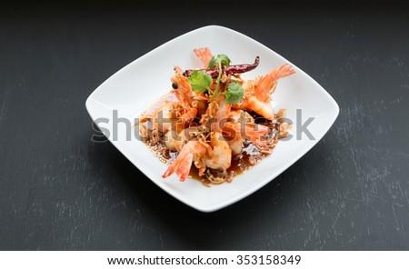 Deep Fried Shrimp with Tamarind Sauce on black background - stock photo